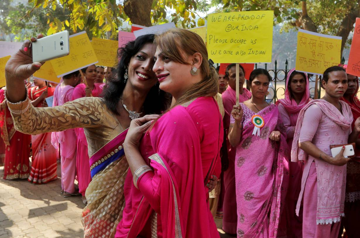 People belonging to the transgender community take a picture wearing saris with a mobile phone before the start of a rally for transgender rights in Mumbai, India, January 13, 2017. | REUTERS/Shailesh Andrade