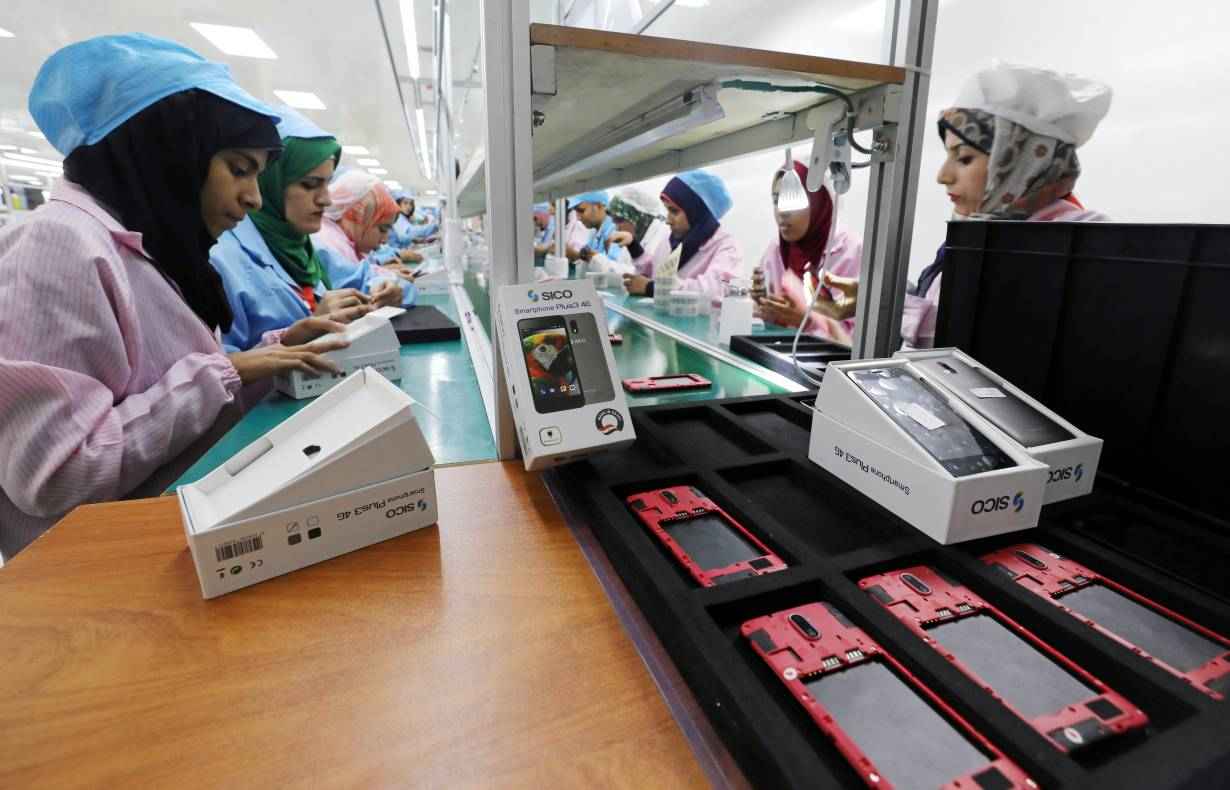 ARCHIVE PHOTO: Women work on a production line at the mobile phone factory in Assuit, Egypt September 30, 2018. | REUTERS/Mohamed Abd El Ghany