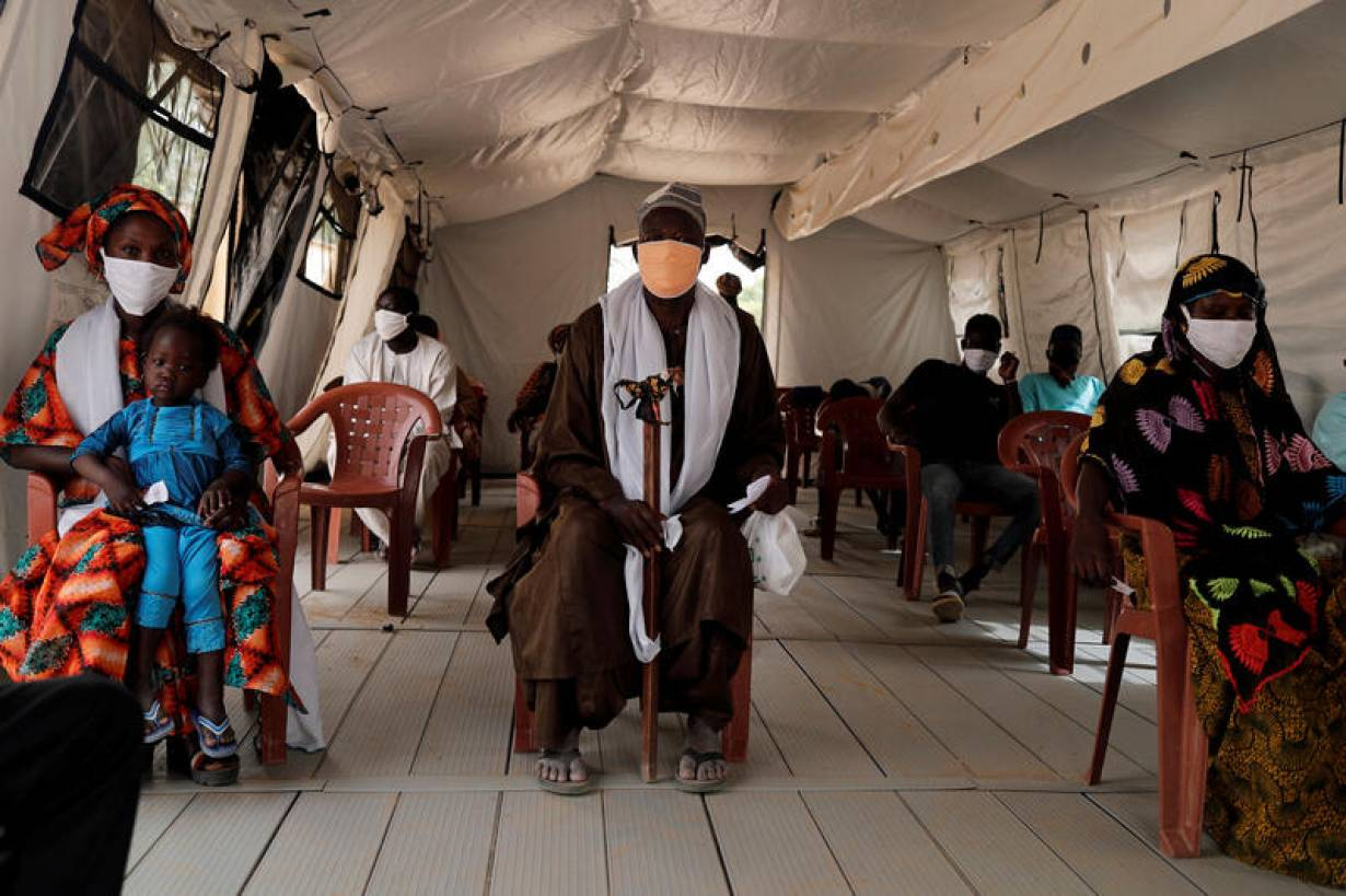 Local residents wait, inside a tent used as a waiting room, their turn for examination at the army field hospital, amid the outbreak of the coronavirus disease (COVID-19) in Touba, Senegal, May 1, 2020. Picture taken May 1, 2020. | REUTERS/Zohra Bensemra