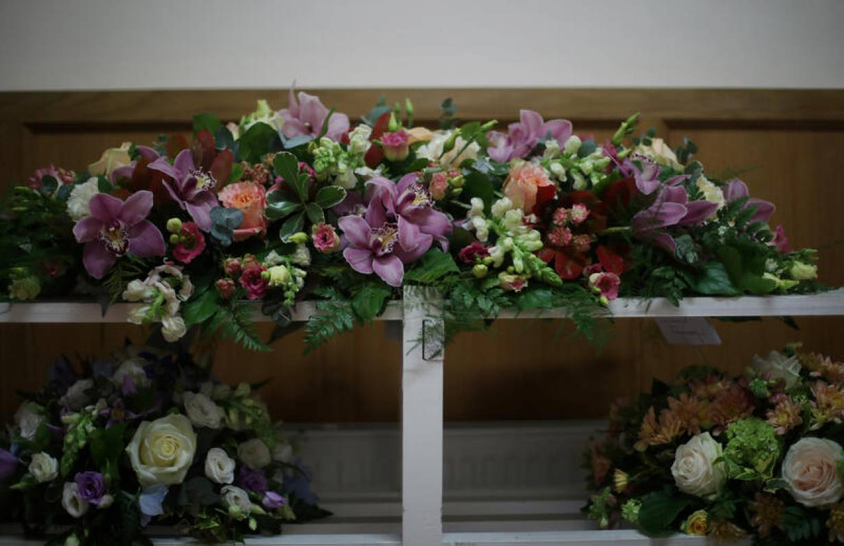 Funeral flowers are seen in the mortuary at Poppy's Funerals in Lambeth Cemetery, as the spread of the coronavirus disease (COVID-19) continues in London, Britain, April 30, 2020. Picture taken April 30. | REUTERS/Hannah McKay