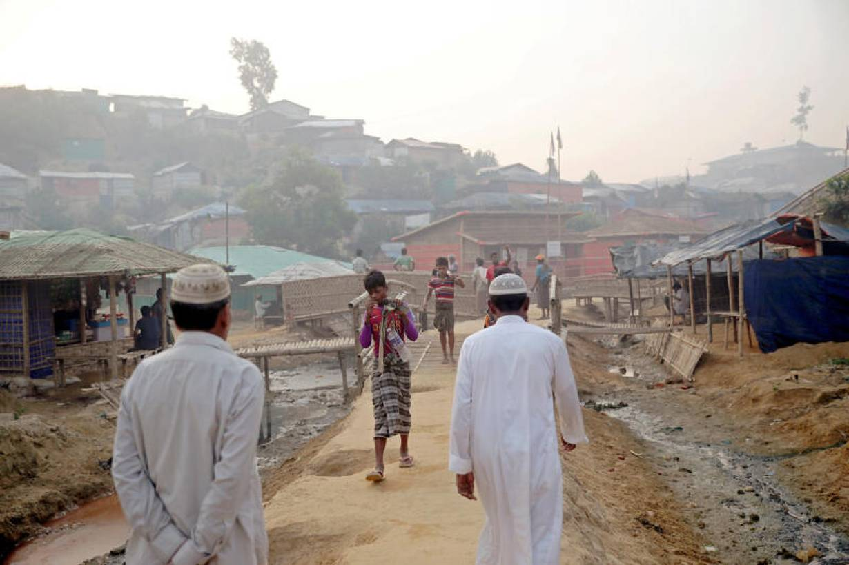 FILE PHOTO: Rohingya refugees walk on a road at the Balukhali camp in Cox's Bazar, Bangladesh, April 8, 2019. | REUTERS/Mohammad Ponir Hossain/File Photo