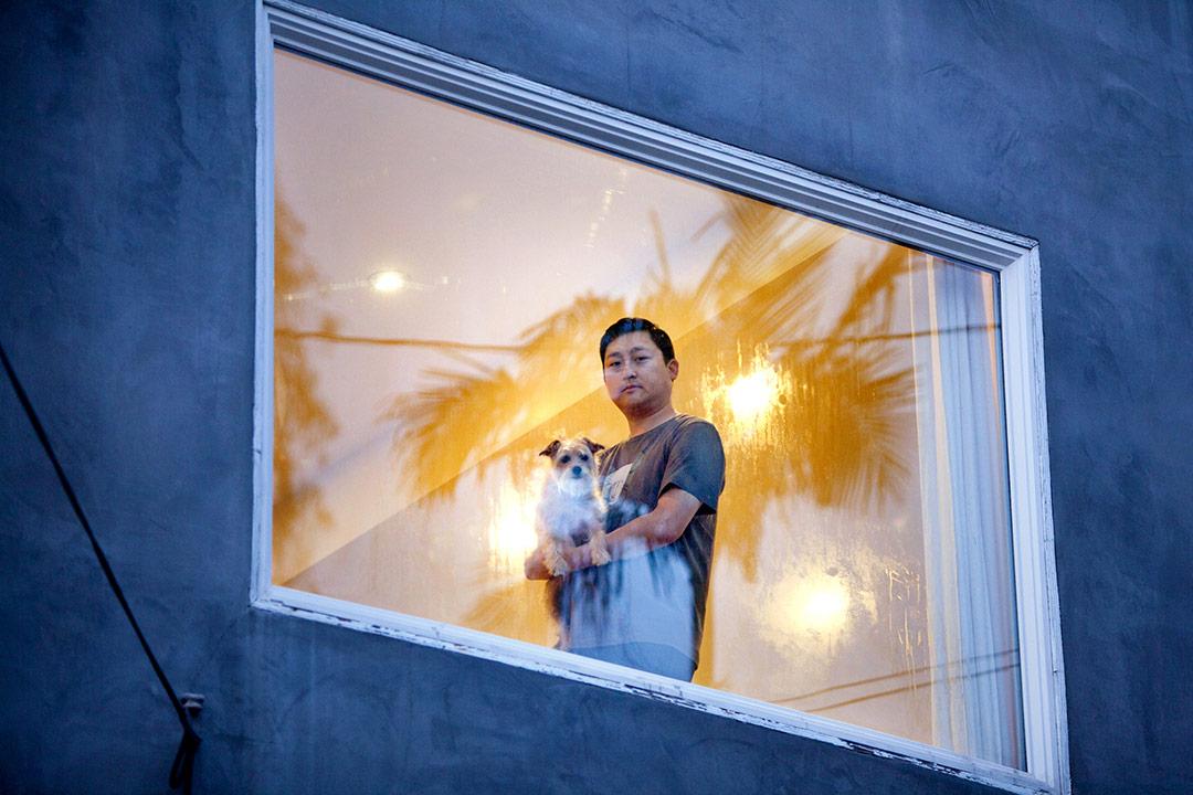 Photographer Sally Ryan snapped pictures of her neighbors with a window separating the camera from the people to symbolize social distancing. | Photographs by Sally Ryan and submitted to the Autry.