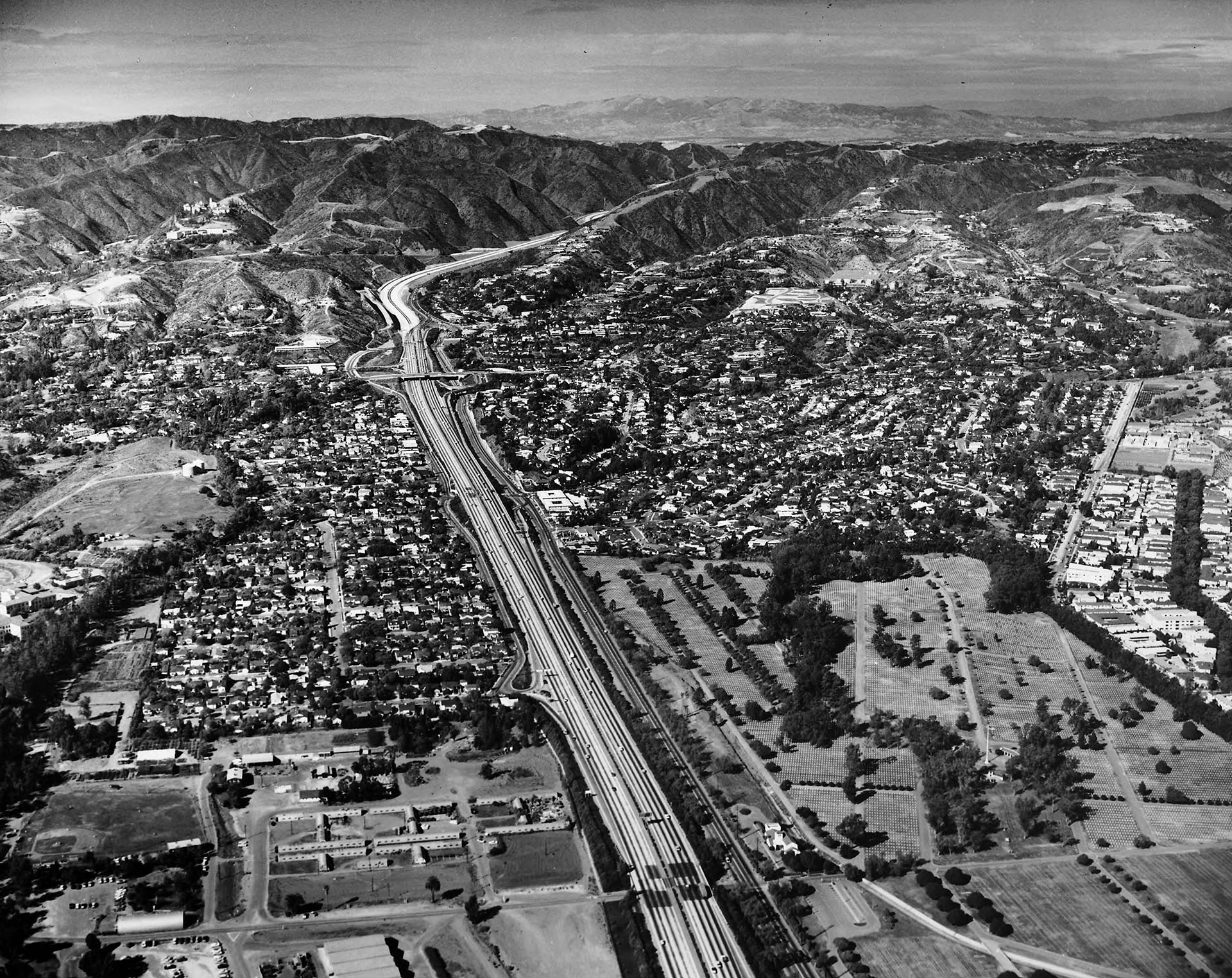 1962 aerial view of the San Diego (I-405) Freeway emerging from the Sepulveda Pass