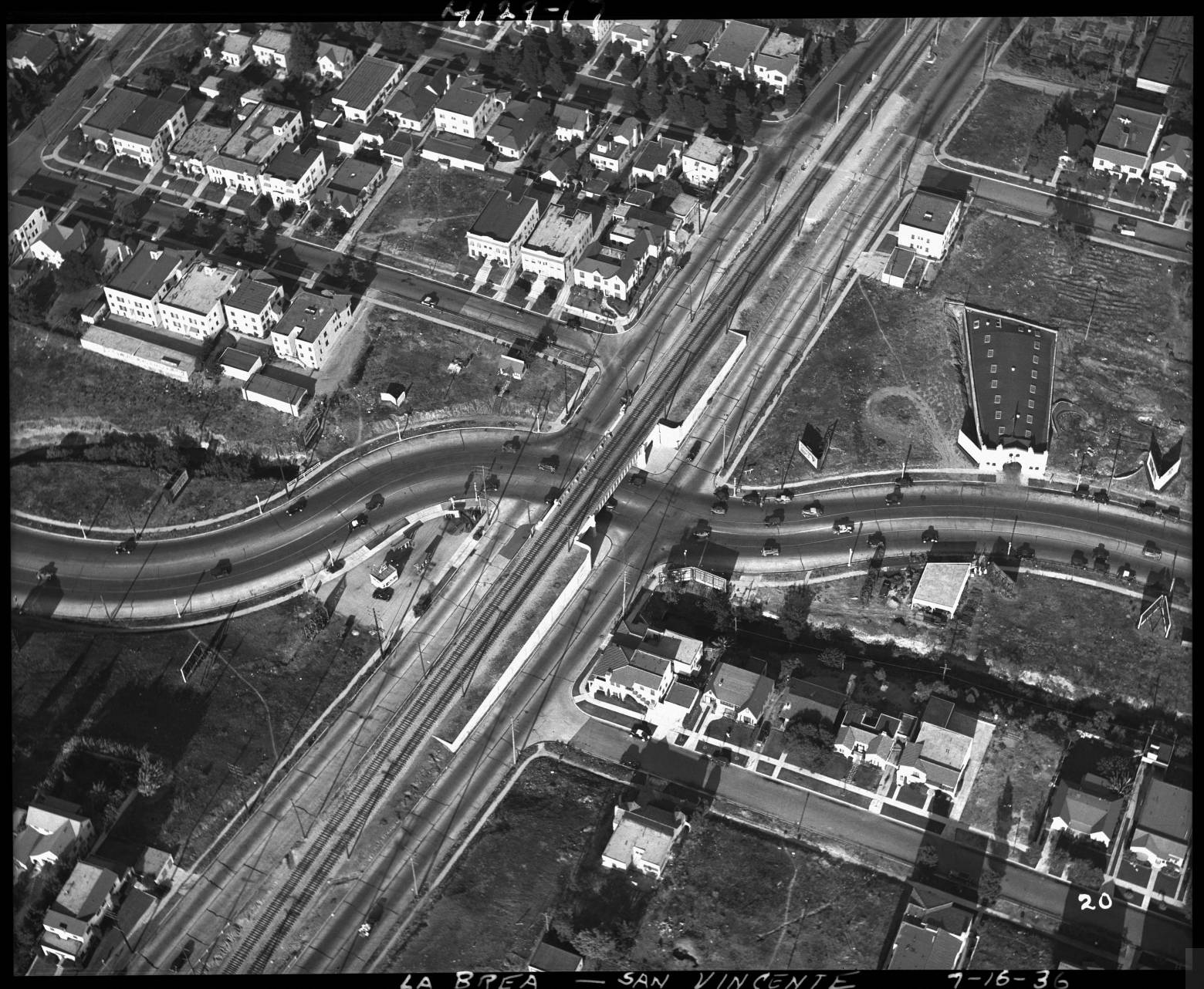 A viaduct over La Brea Avenue at San Vicente separated streetcar from automobile traffic. 1936 aerial photo courtesy of the Automobile Club of Southern California Archives.