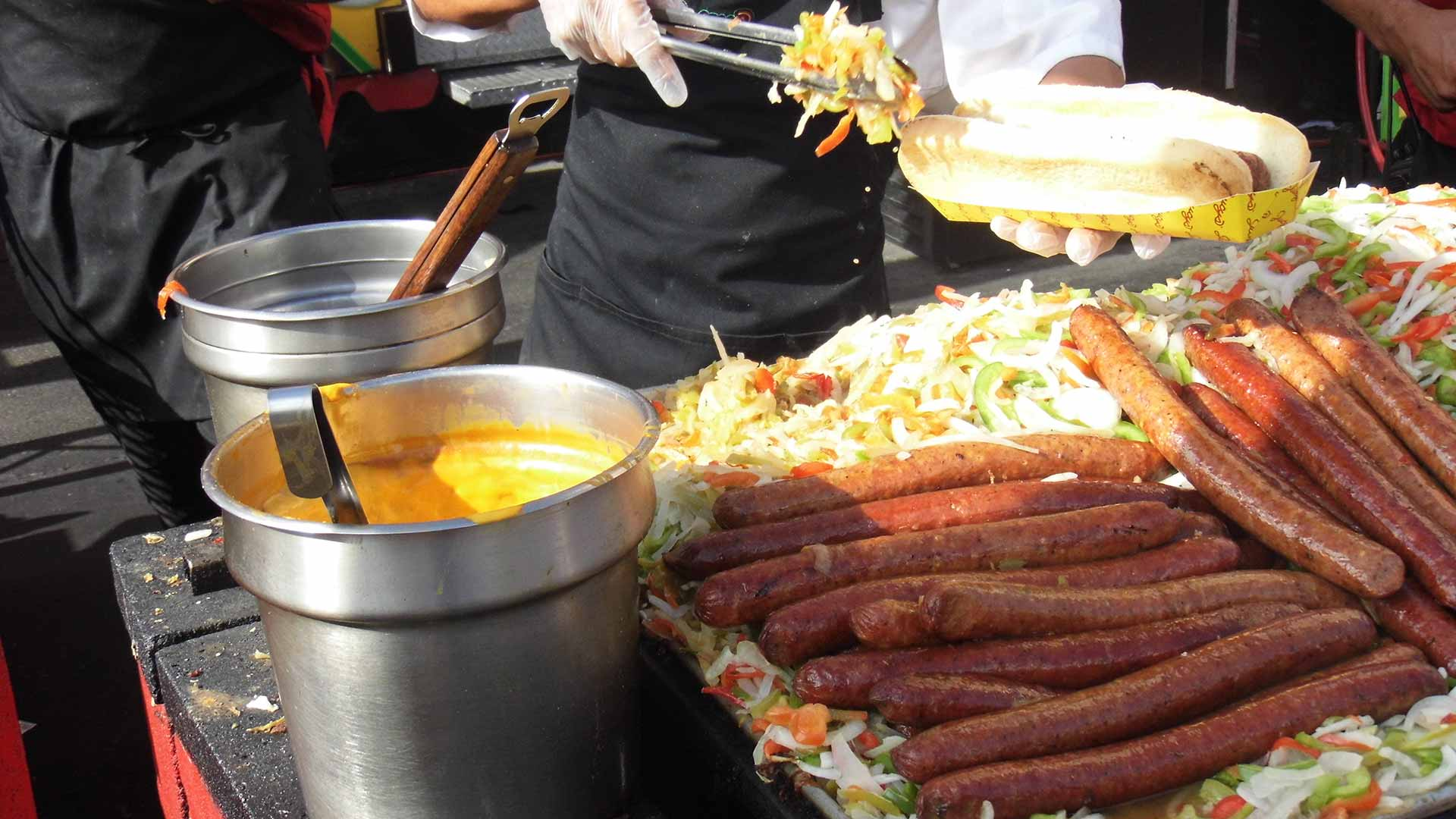 Sausages, veggies and cheese being cooked at the San Diego County Fair