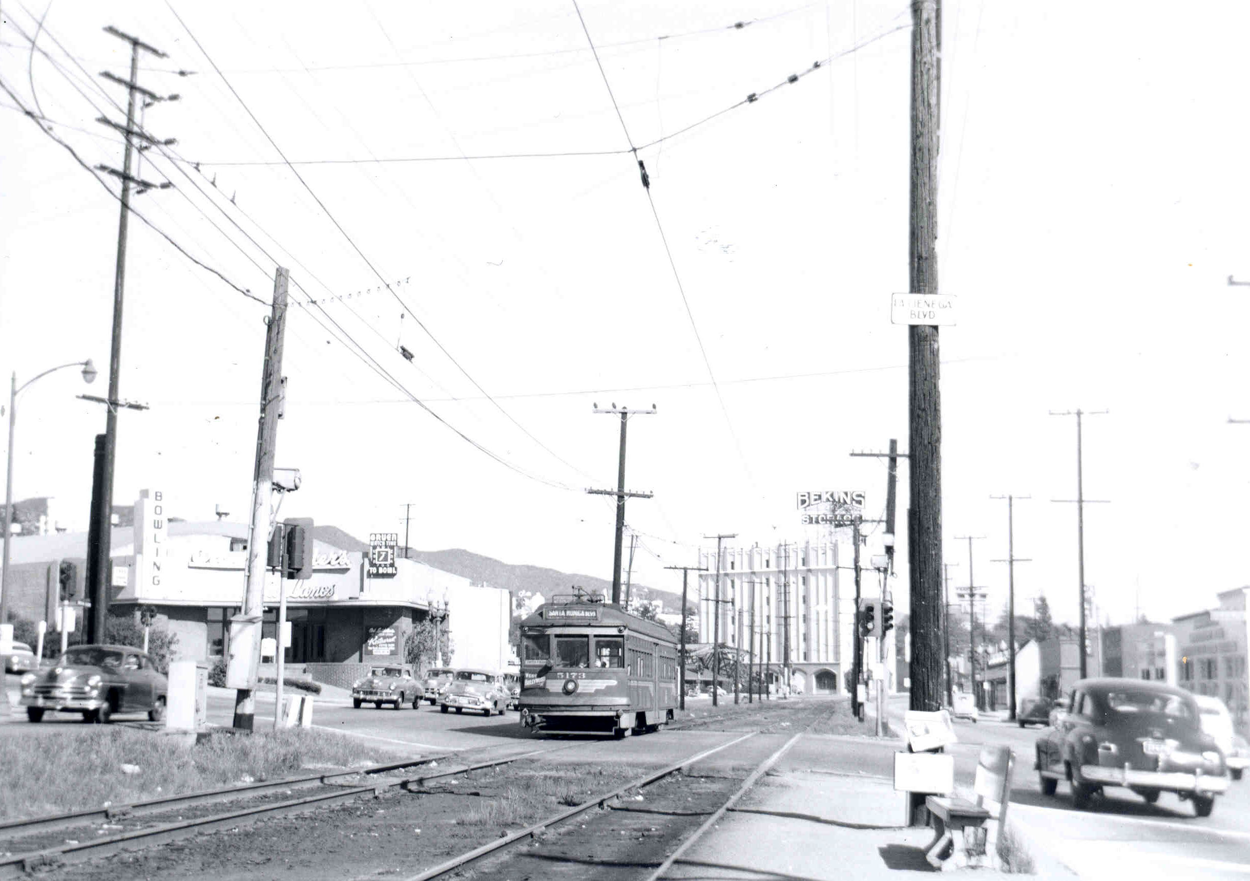 Electric railway tracks once ran down the median of Santa Monica Boulevard, shown here in West Hollywood in 1951. Courtesy of the Metro Transportation Library and Archive.
