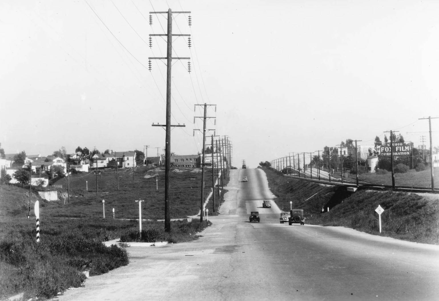 Santa Monica Boulevard parallels Pacific Electric tracks in this 1935 photo, taken at Pandora Avenue looking east. Courtesy of the USC Libraries - California Historical Society Collection.