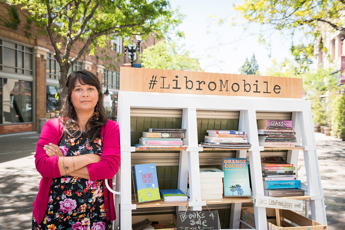 Sarah Rafael García poses next to her LibroMobile mobile library. | Courtesy of Sarah Rafael García