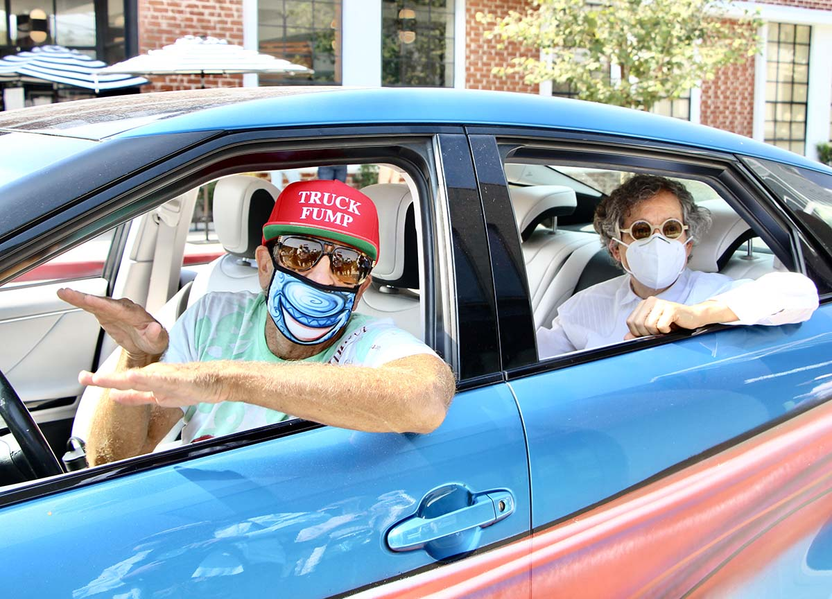 "Kenny Scharf and Jeffrey Deitch inside a car during the ""Karbombz!"" car parade | Jordan Riefe"