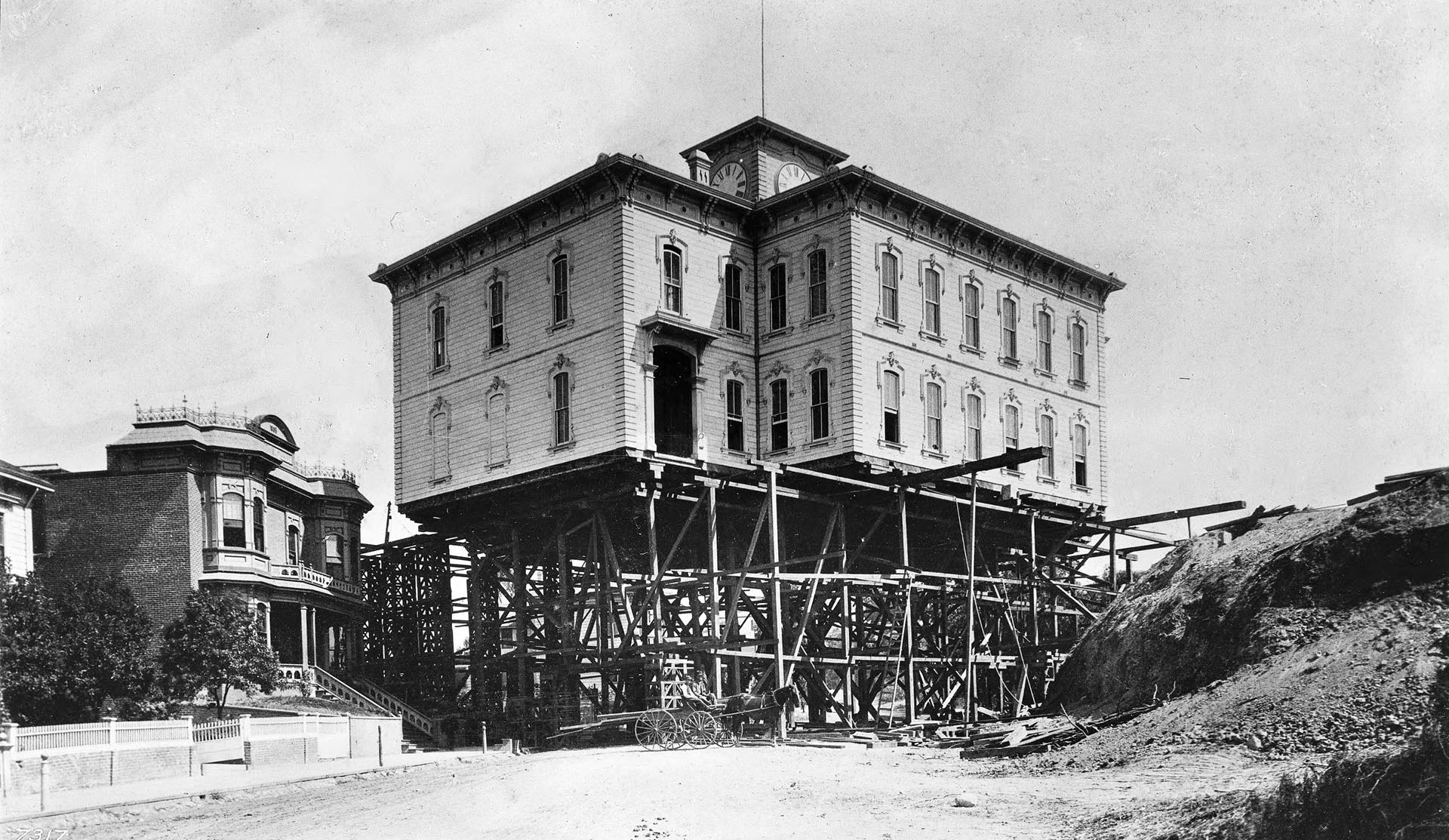 In 1886, house-moving contractors hoisted the Los Angeles Central School building on stilts and moved it across the city. Courtesy of the USC Libraries - California Historical Society Collection.