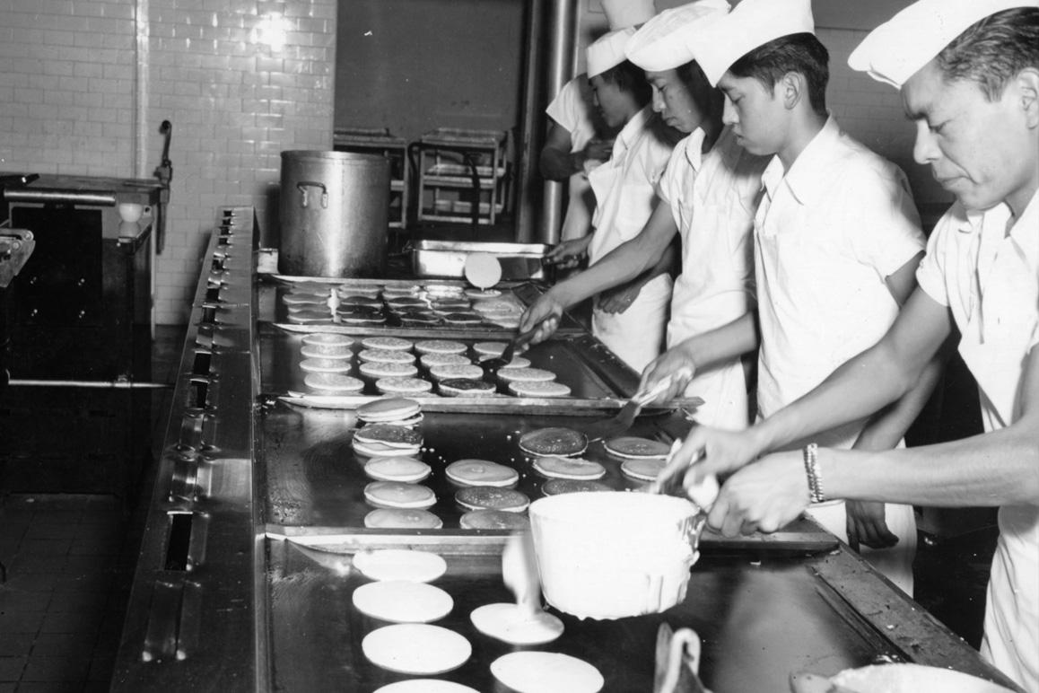 Young men preparing pancakes for Sherman Indian School students. Credit: Sherman Indian Museum.