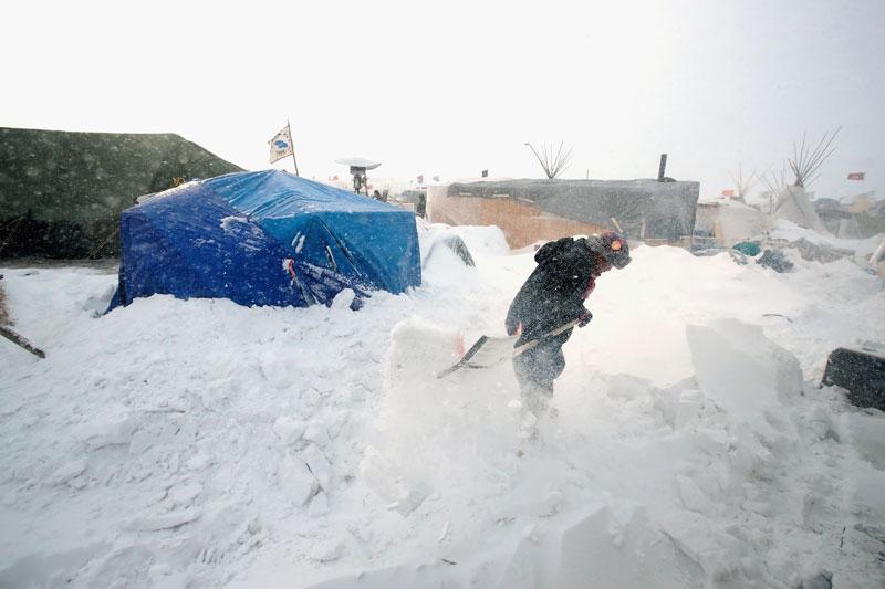 Shoveling snow at Standing Rock