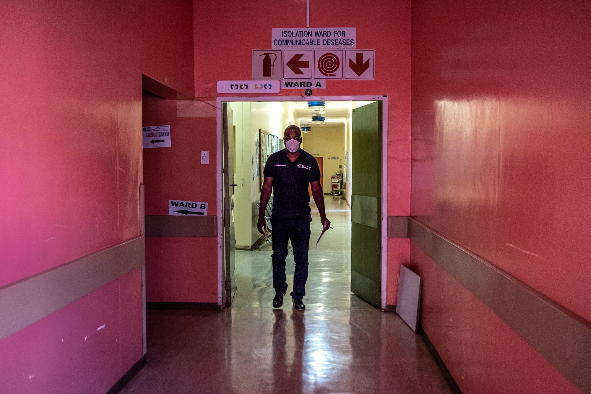 Specialist ICU Nurse Vicky Shikwambana, who is also the COVID-19 Ward Manager walks through the corridors of the Taung Hospital in Taung, the North West Province, South Africa, on Sept. 4, 2020.   Thomson Reuters Foundation/Gulshan Khan