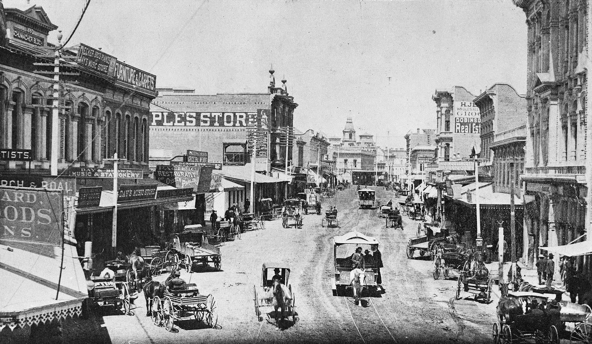 Horse-drawn buggies, carts, wagons, and streetcars move down Spring Street in this circa 1884 view. Courtesy of the USC Libraries - California Historical Society Collection.