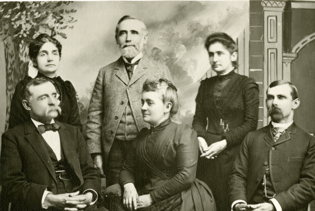 Lyman Stewart (standing, center) with his family