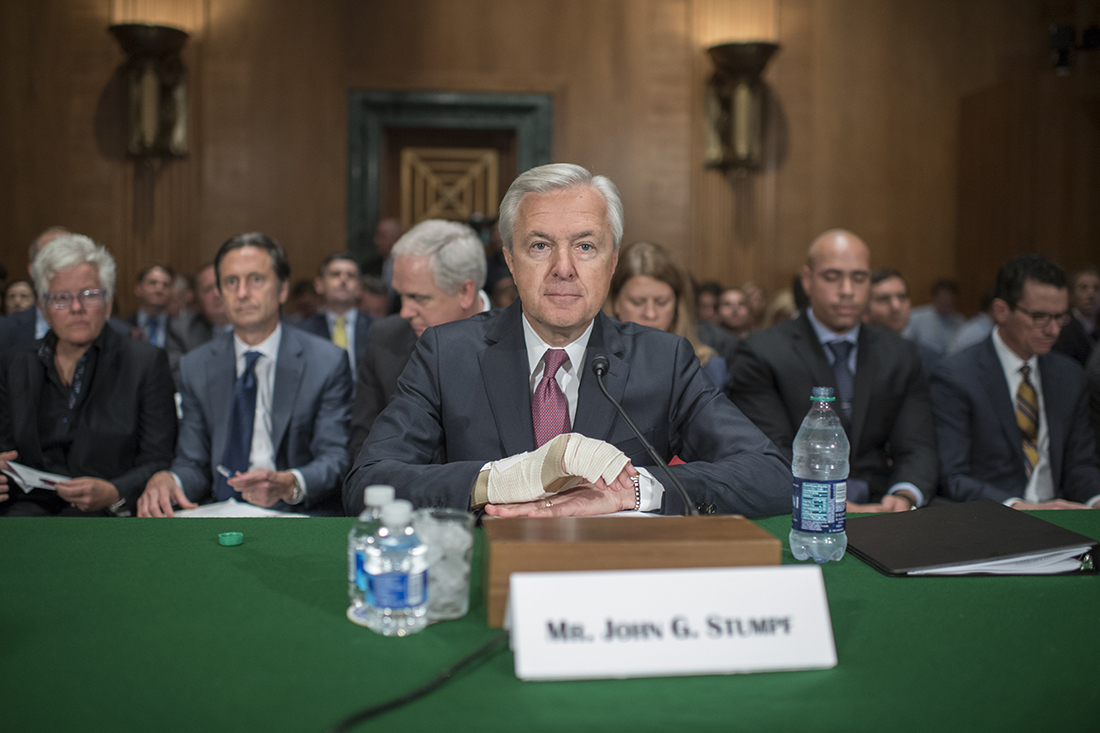 Wells Fargo CEO John Stumpf, center, prepares to testify at a Senate Banking, Housing, and Urban Affairs hearing in Dirksen Building, September 20, 2016, on the company's unauthorized accounts opened under customers' names. | Getty Images