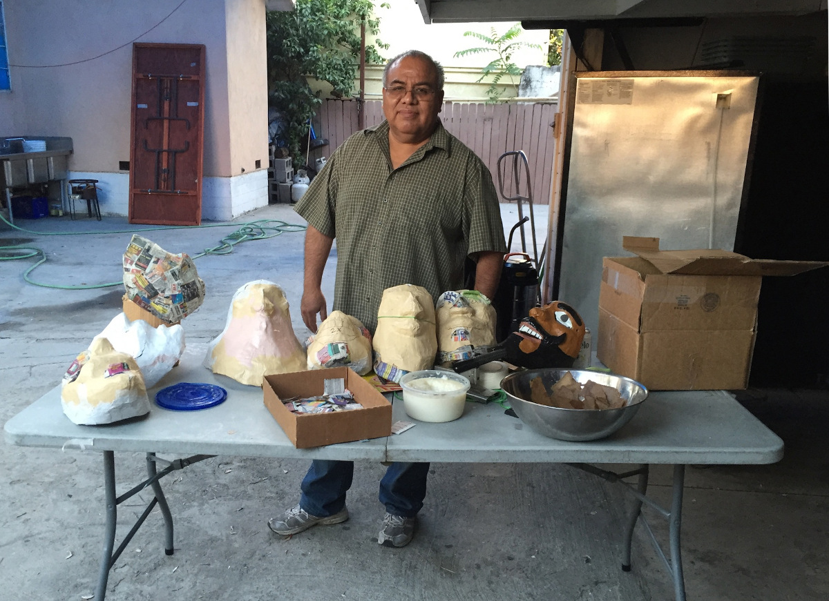 Ted Lazaro with Oaxacan masks