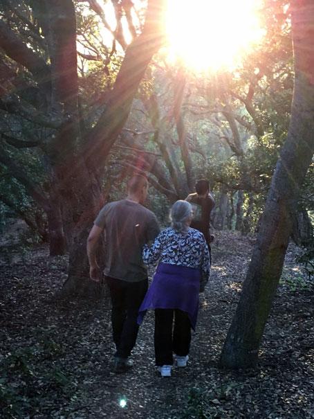 Vincent Medina holds on to an elder during a nature walk. | Courtesy of Vincent Medina