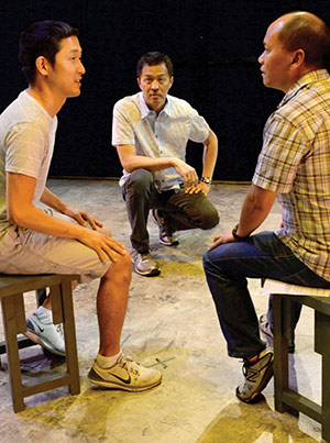 """Rehearsal for """"Beijing Spring"""" with actor Daniel May (l), director Tim Dang (c), and actor Radmar Agana Jao (r). 