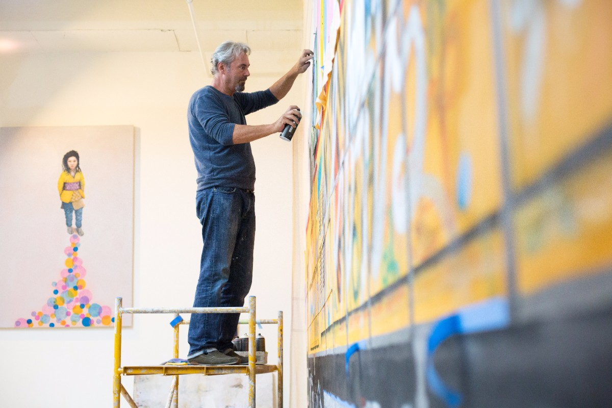 Tobias Keene works on a large wall painting for an upcoming exhibition. | Magali Gauthier Santa Fe Art Colony