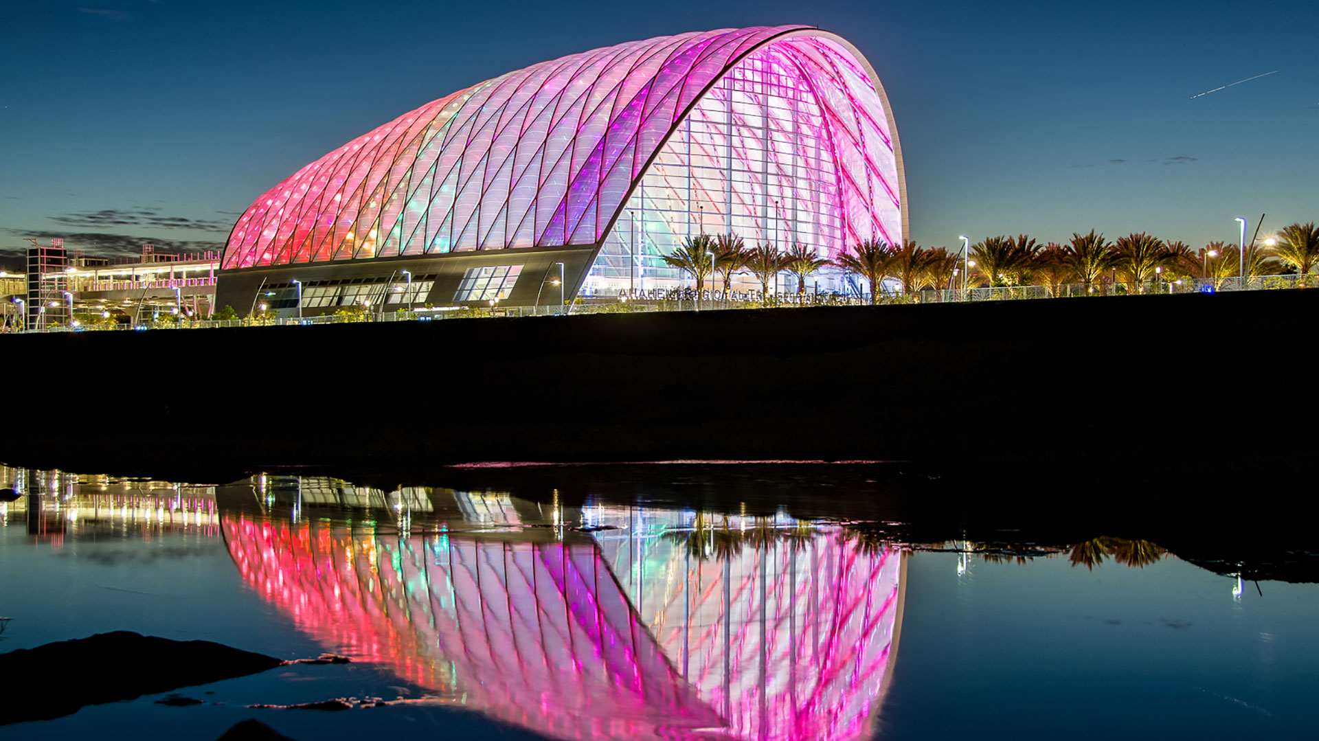 Outdoor evening shot of the Anaheim Regional Transportation Intermodal Center overlooking the Santa Ana River.