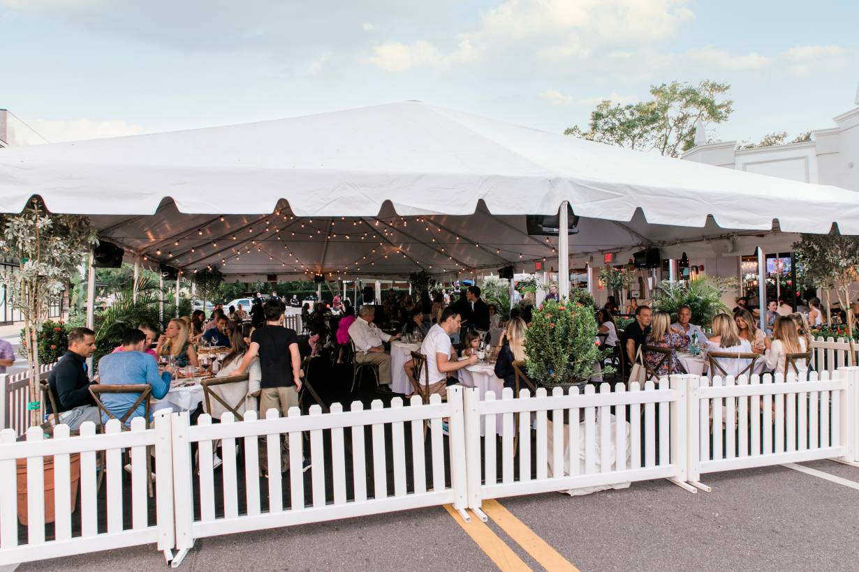 iners eat in a tent set up on a street outside the Forbici Modern Italian restaurant in Tampa, Florida, in May amid the coronavirus pandemic. | Handout photo by Amy Pezzicara / Pezz Photo
