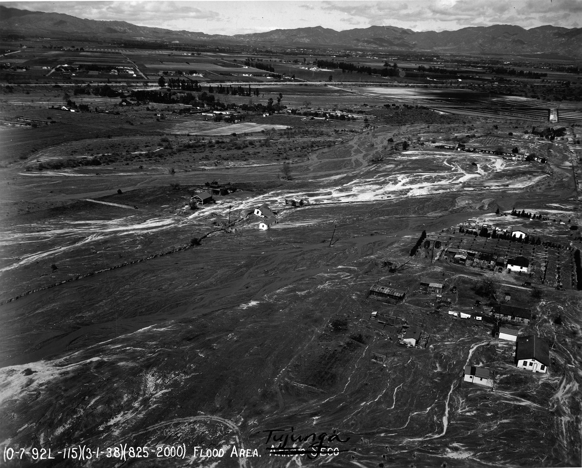 Houses caught in a flooded Tujunga Wash in March 1938
