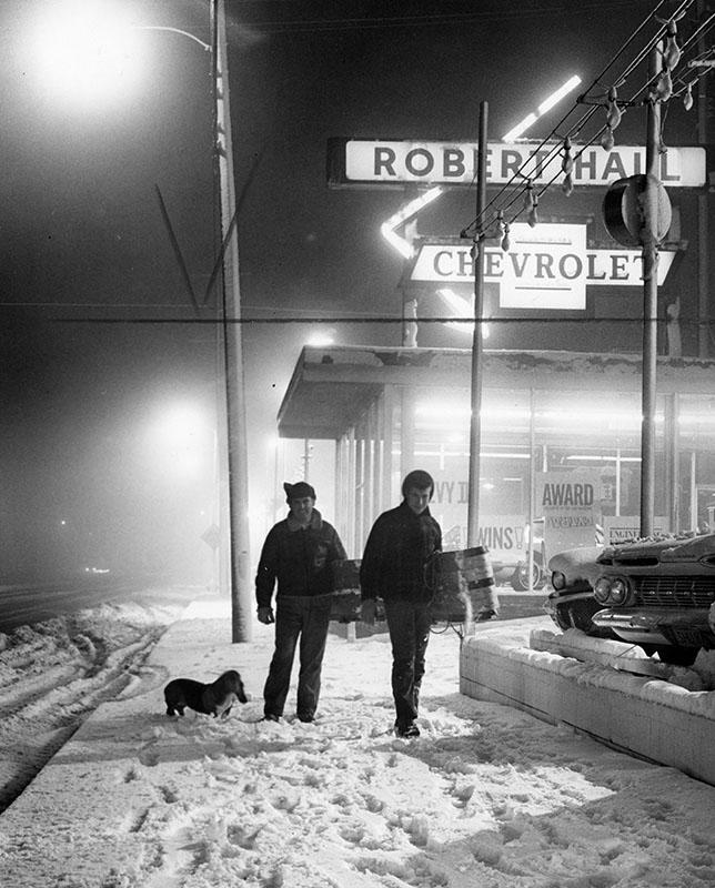 David and Bob Naranjo drag a toboggan down a Tujunga street after the snowstorm of 1962