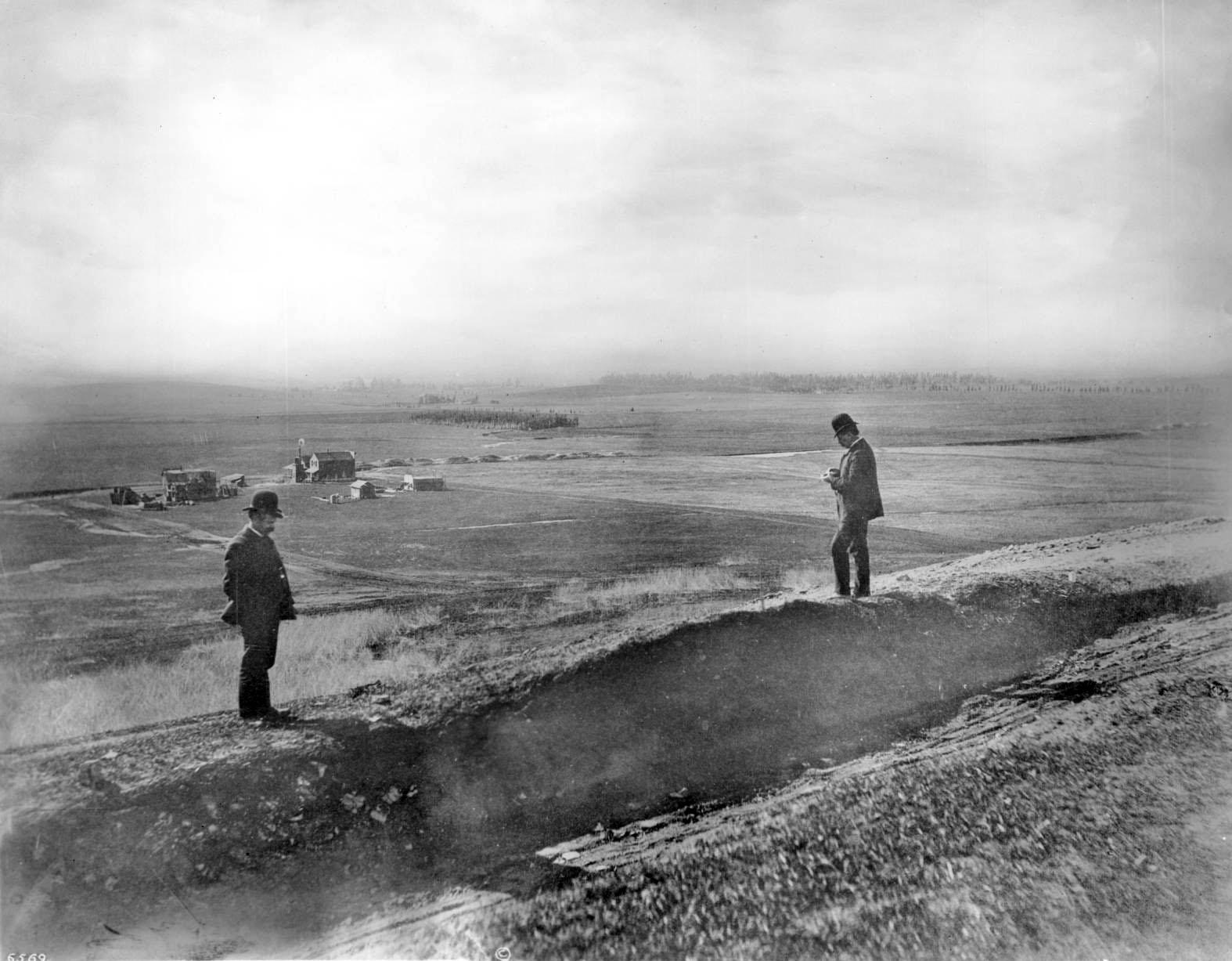 Two men stand on Olive Hill, located to the east of Hollywood, circa 1905.