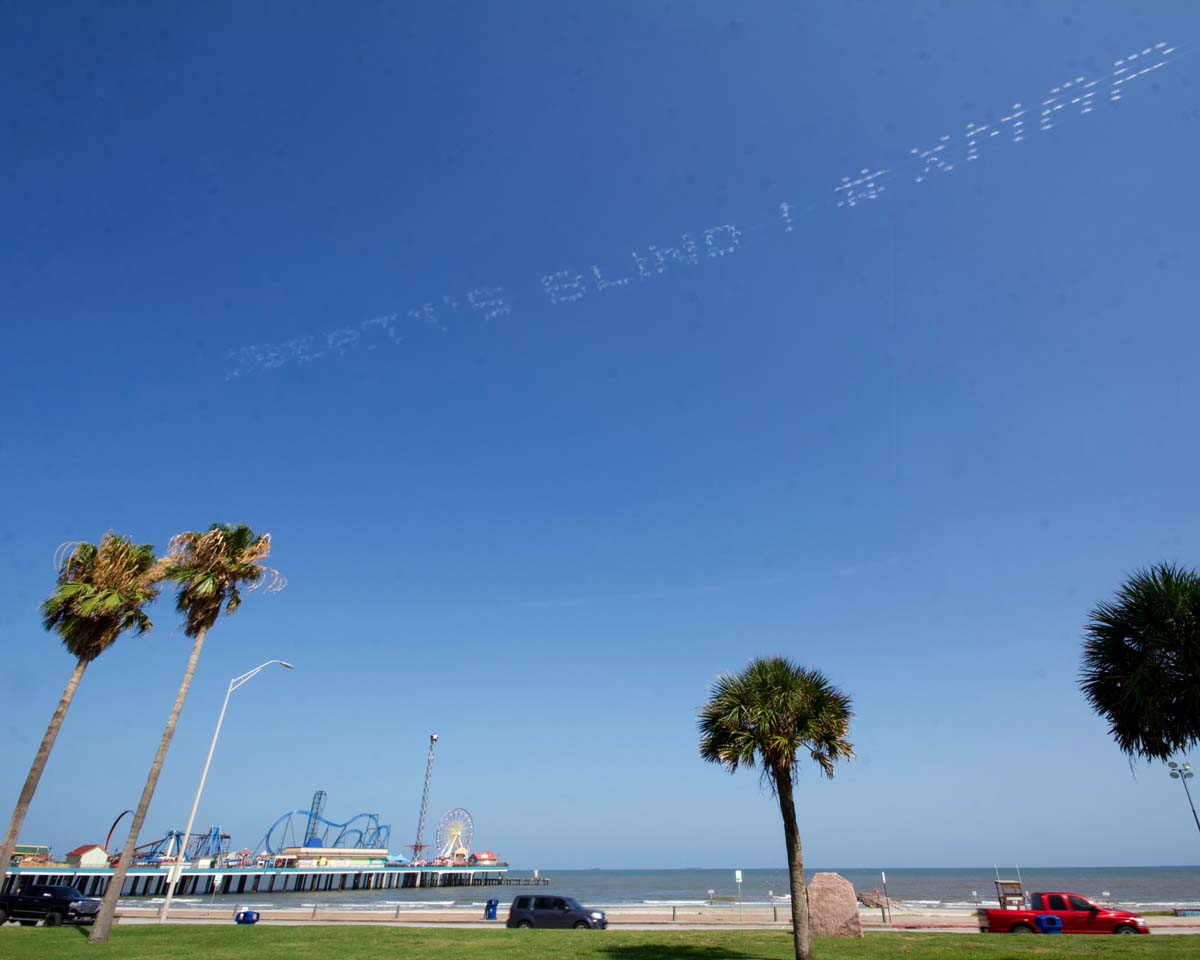 """""""LIBERTY'S BLIND #XMAP"""" written in in the sky, contributed by Robin Hemley over Galveston, Texas 