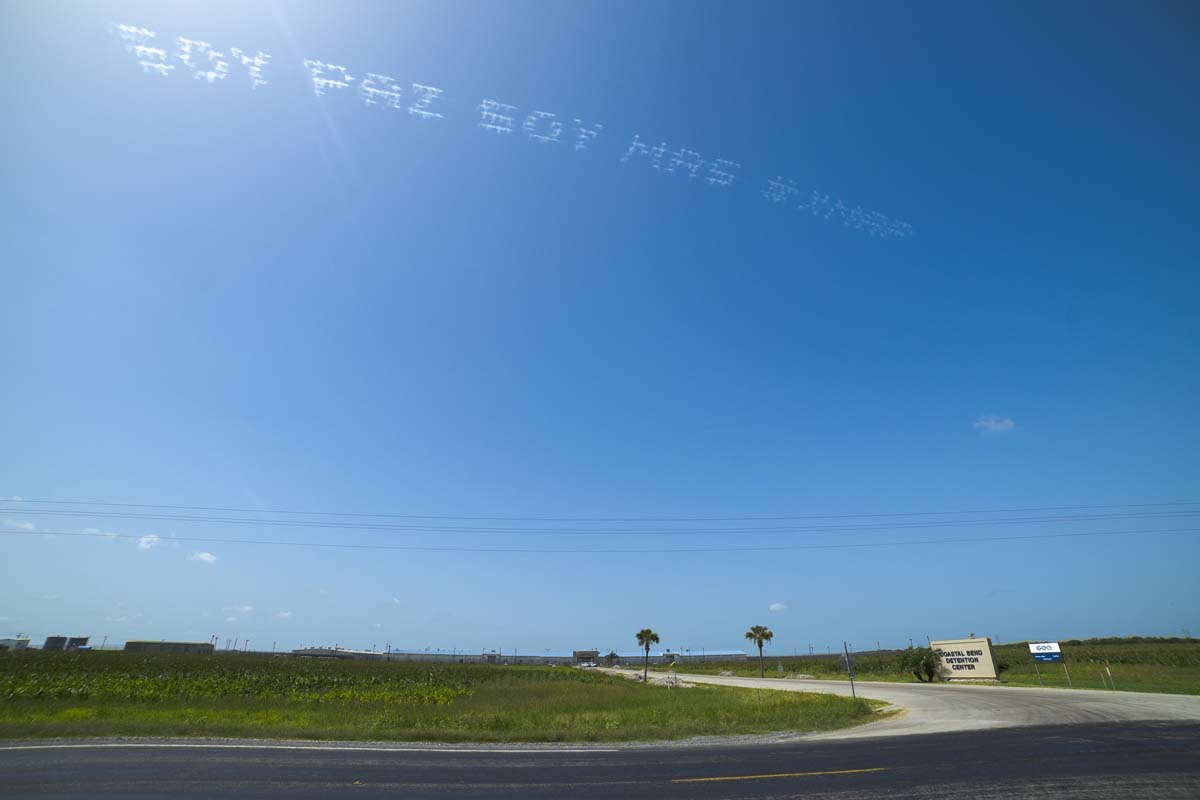 """""""SOY PAZ SOY MAS #XMAP"""" written in in the sky, contributed by Maria Gaspar over Coastal Bend Detention Center 