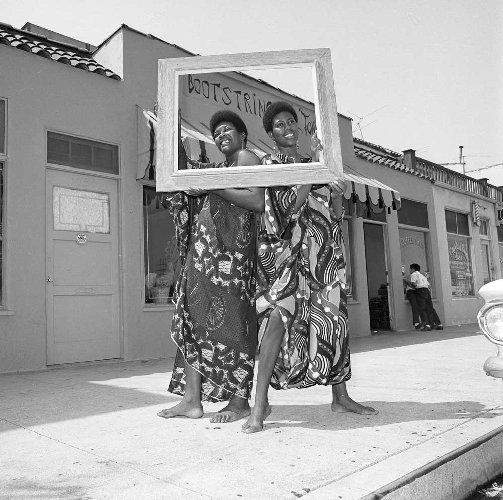 People showing off the Boostring clothing collection | UCLA, Library Special Collections,Los Angeles Times Photographic Archives