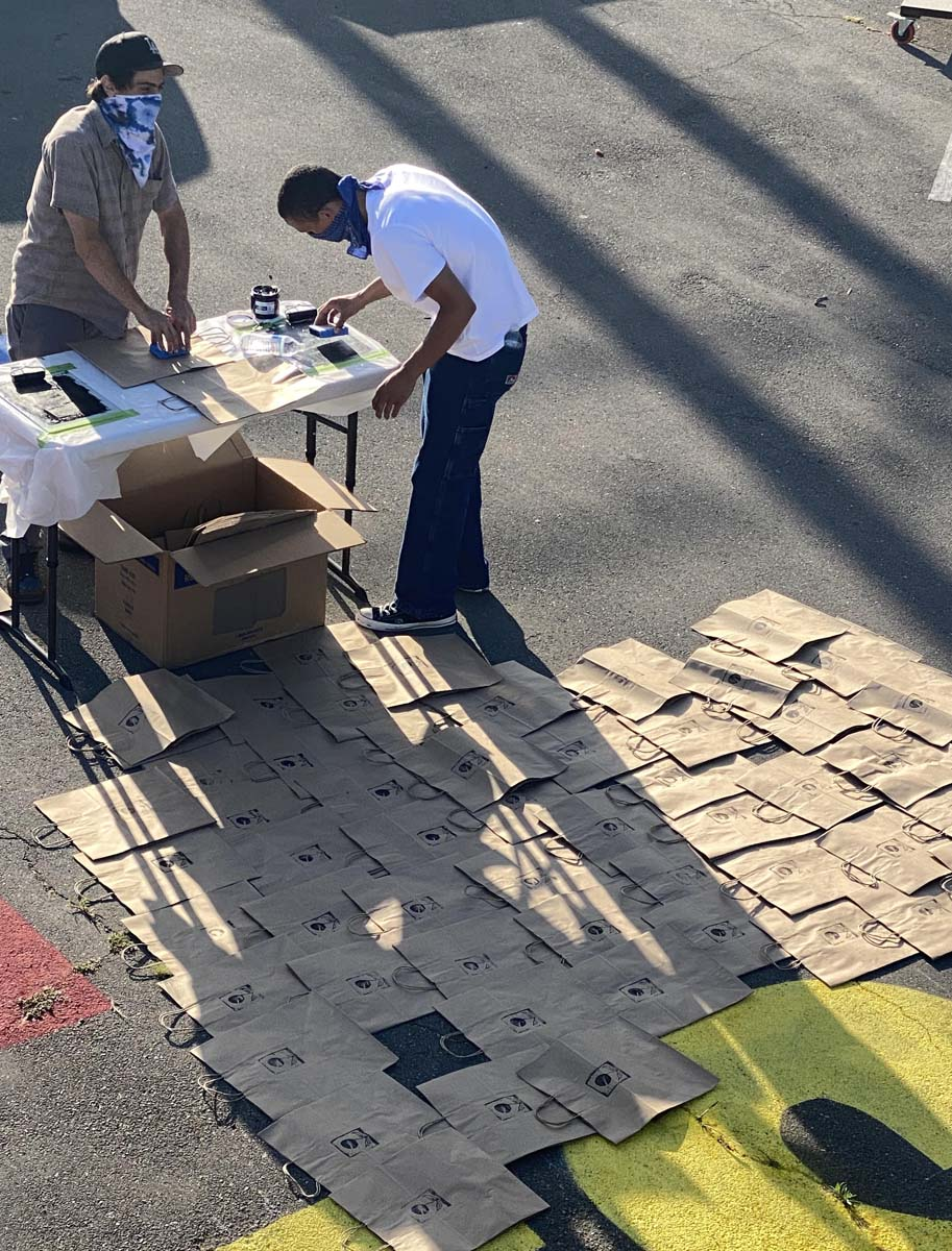 Volunteers prepare the art supply kits for high schoolers | Courtesy of Crenshaw Dairy Mart