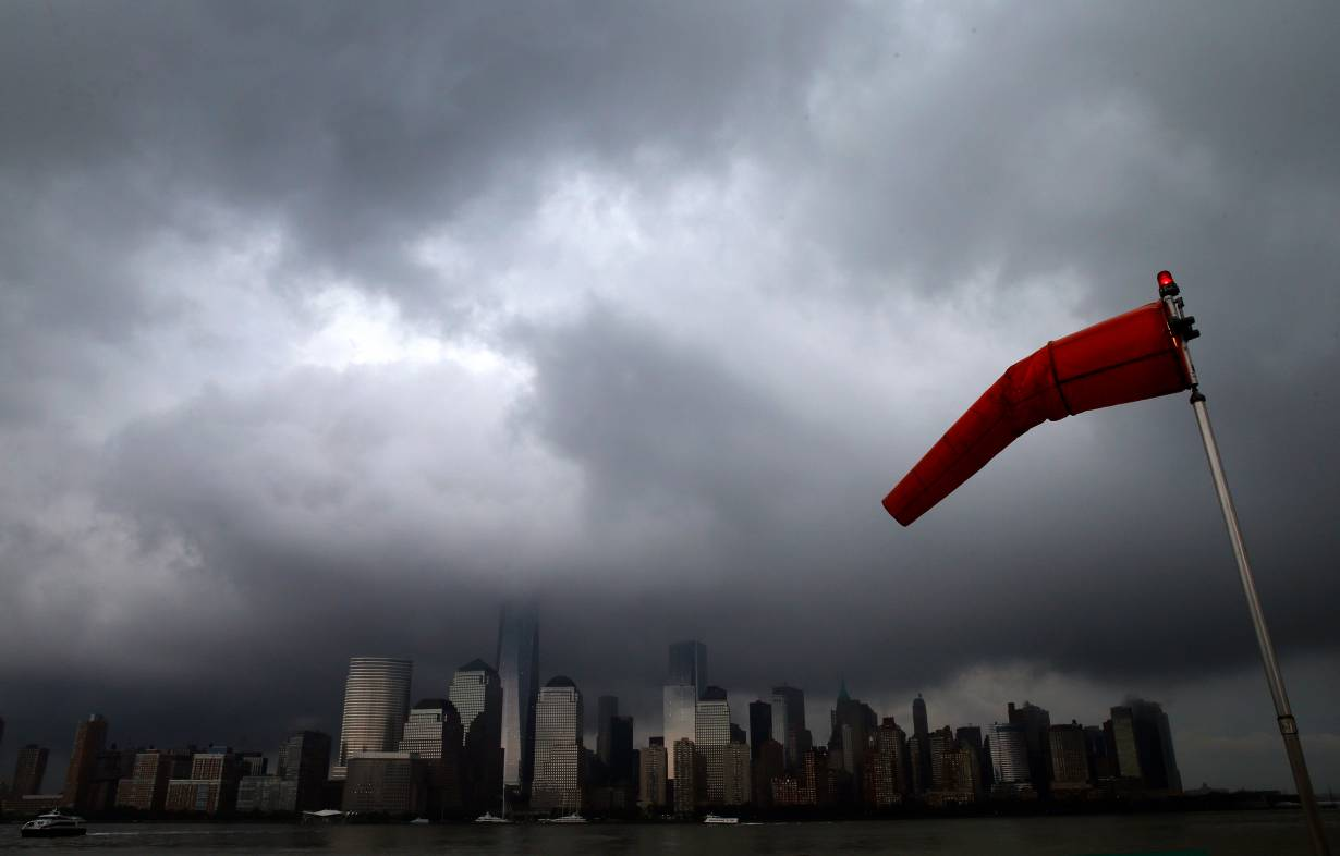 ARCHIVE PHOTO: A wind sock blows in the wind, as a heavy thunderstorm passes over the New York City skyline of lower Manhattan in the background, on the Jersey City shoreline July 15, 2014. REUTERS/Mike Segar