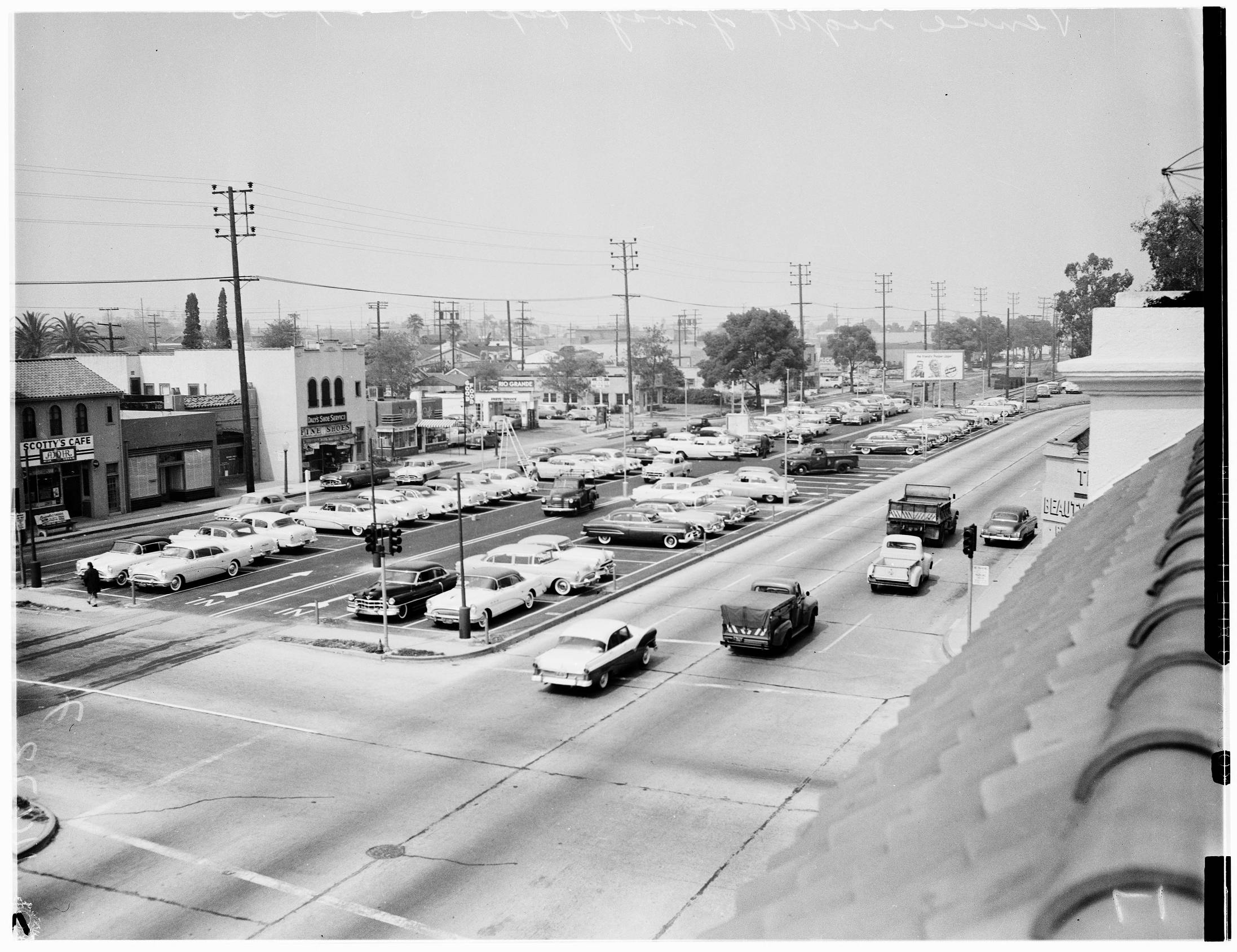 In 1955, a Culver City auto dealership used the abandoned median of Venice Boulevard as a storage lot. Courtesy of the USC Libraries - Los Angeles Examiner Collection.
