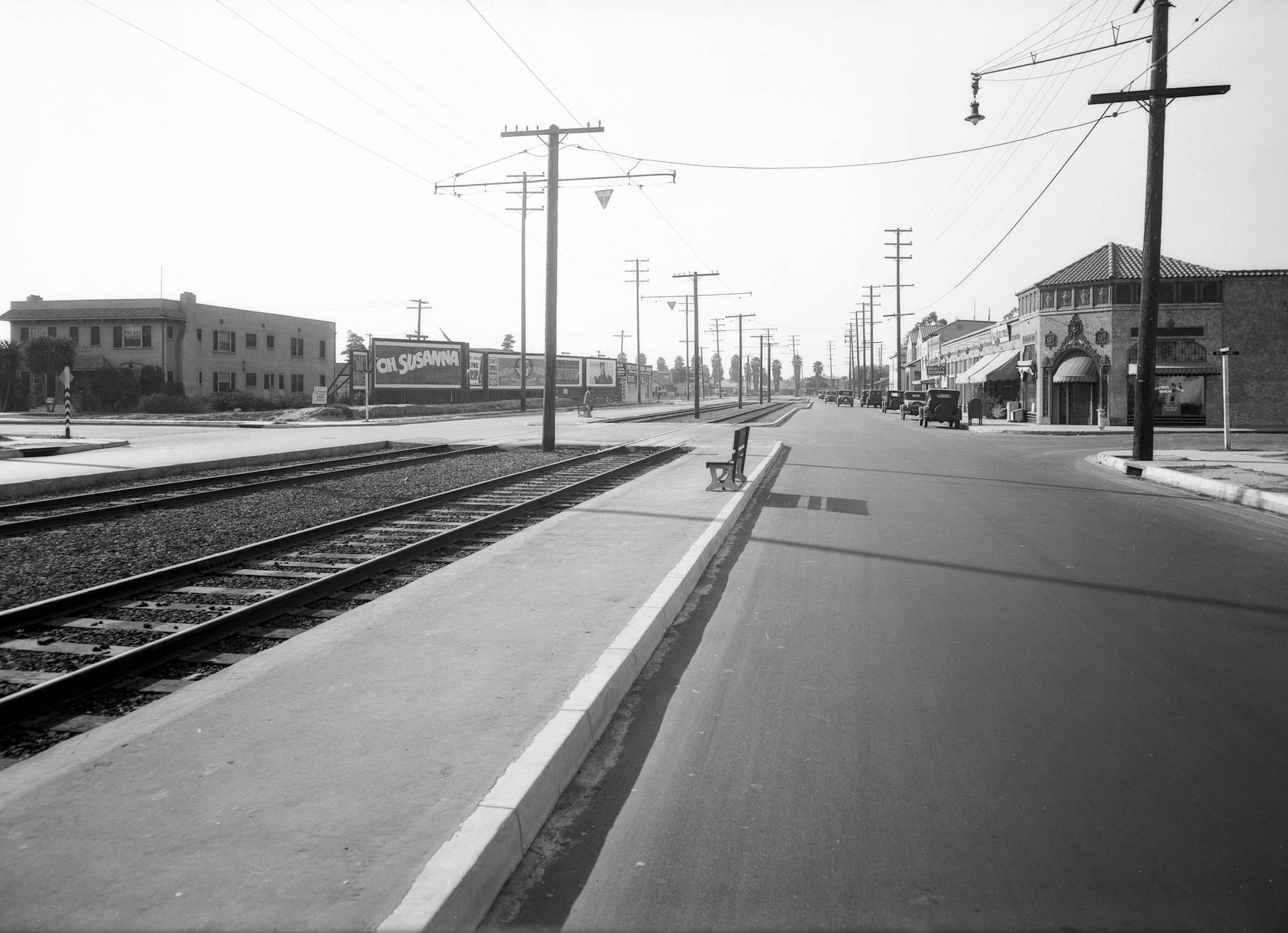 Electric railway tracks once ran down the median of Venice Boulevard, seen here at Fifth Avenue in 1929. Courtesy of the USC Libraries - Dick Whittington Photography Collection.