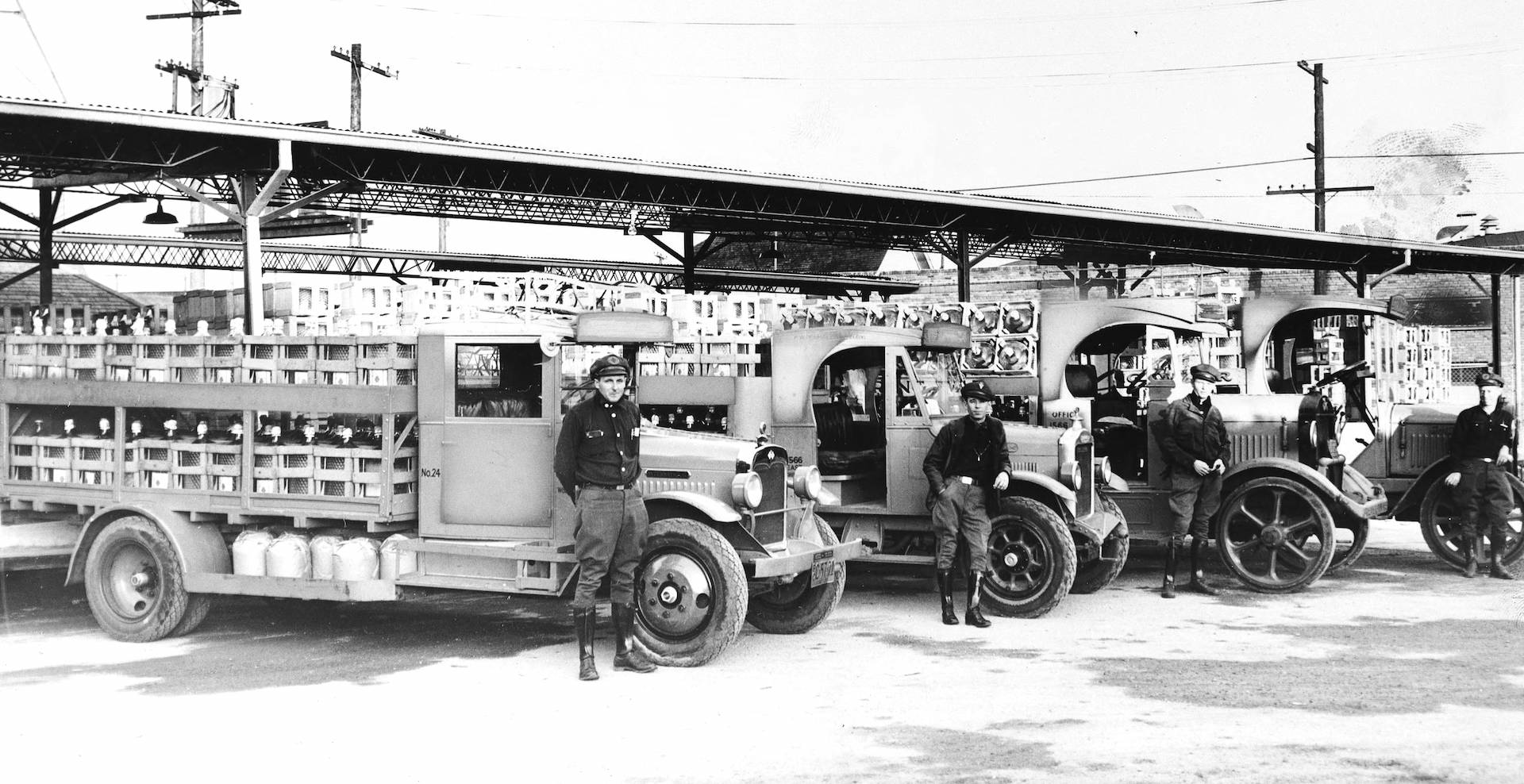 View of Arrowhead Water Company trucks and drivers, 1930-1940