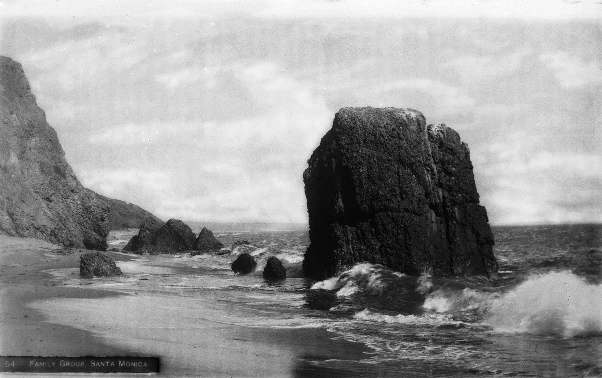 Haystack Rock and the Family Group, located on the beach beneath Castle Rock. Courtesy of the Title Insurance and Trust, and C.C. Pierce Photography Collection, USC Libraries.
