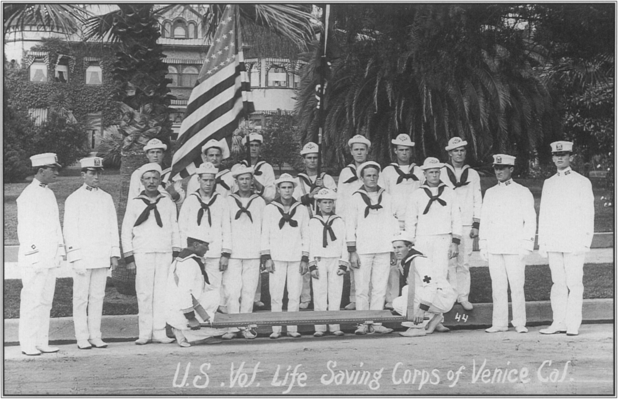 Deservedly proud of the U.S. Volunteer Life Saving  Corps of  Venice,  Captain  George  Freeth,  standing  at  the far left, reviews his crew in 1909. Courtesy Los Angeles County Lifeguard Trust Fund, Elayne Alexander Collection.