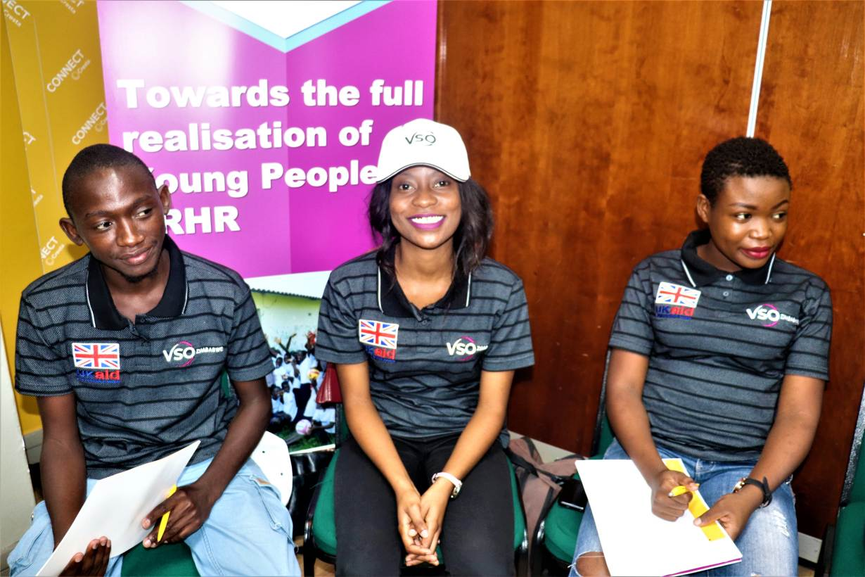 Youth delegates smile for a team photo at a Voluntary Service Oversees (VSO) induction in Harare, Zimbabwe. 20 November 2019. | Bessie Siyado/Handout via Thomson Reuters Foundation