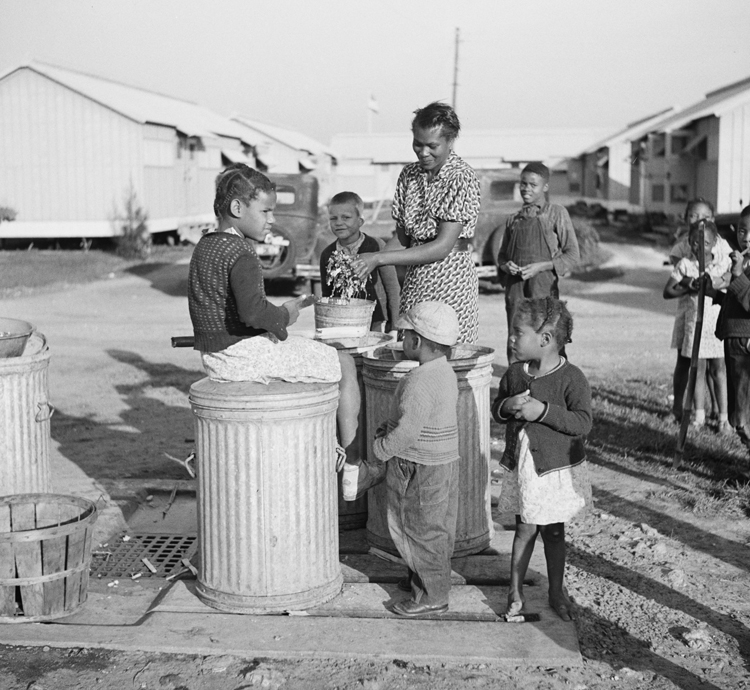 Washing greens at the Okeechobee migratory labor camp, Belle Glade, Florida, 1941. Photo by Marion Post Wolcott | Library of Congress
