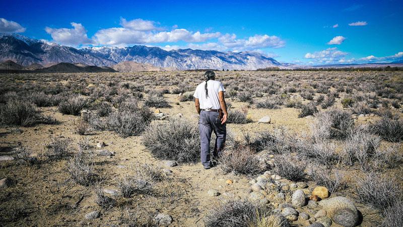 Paiute elder Harry Williams at irrigation ditch