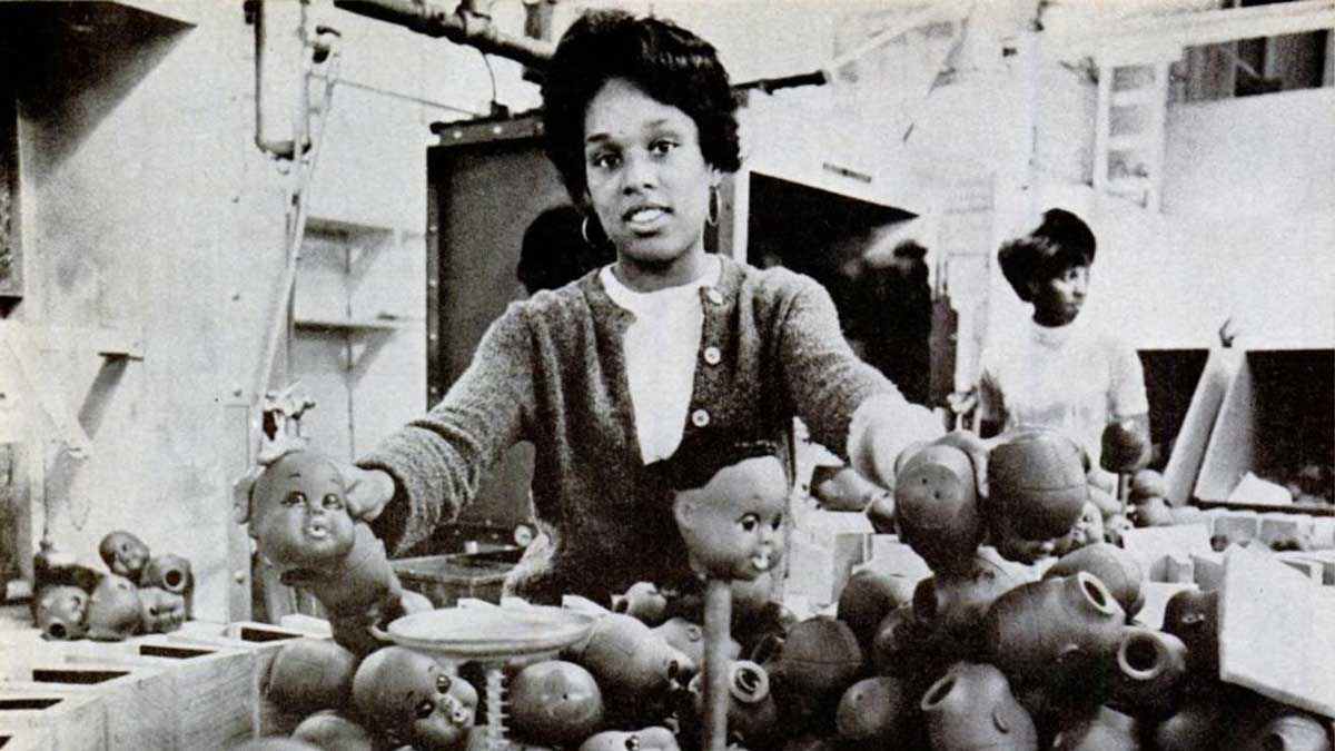 """A woman manufacturing Shindana Toy dolls from a Jet Magazine story published by Johnson Publishing Company 