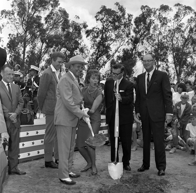Anaheim Mayor Odra Chandler and contractor Del Webb look on as Angels owner Gene Autry and actress Pat Wymore break ground on Anaheim Stadium on August 30, 1964.