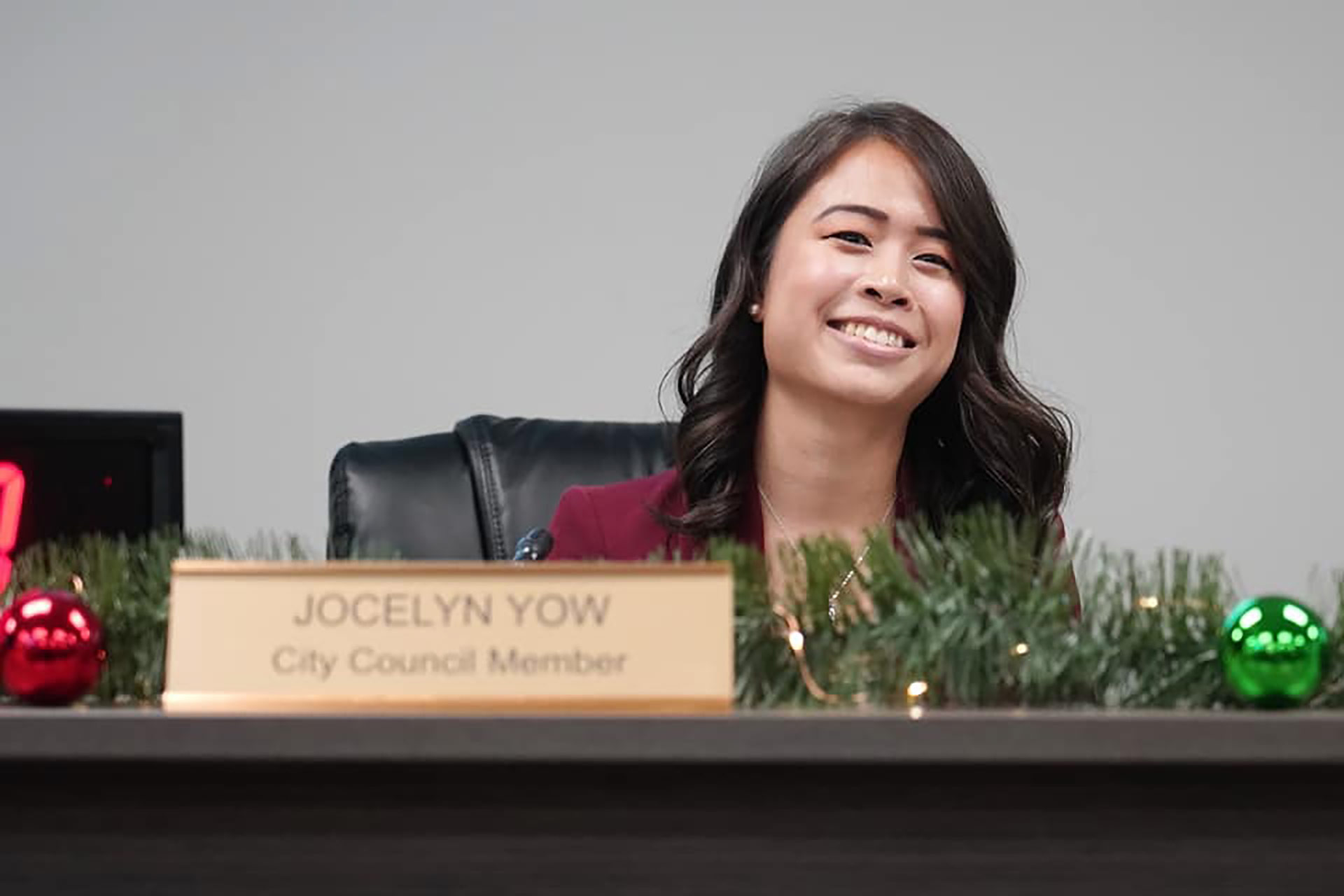 Jocelyn Yow smiles at her desk during her city council swearing in ceremony. | Courtesy of Jocelyn Yow