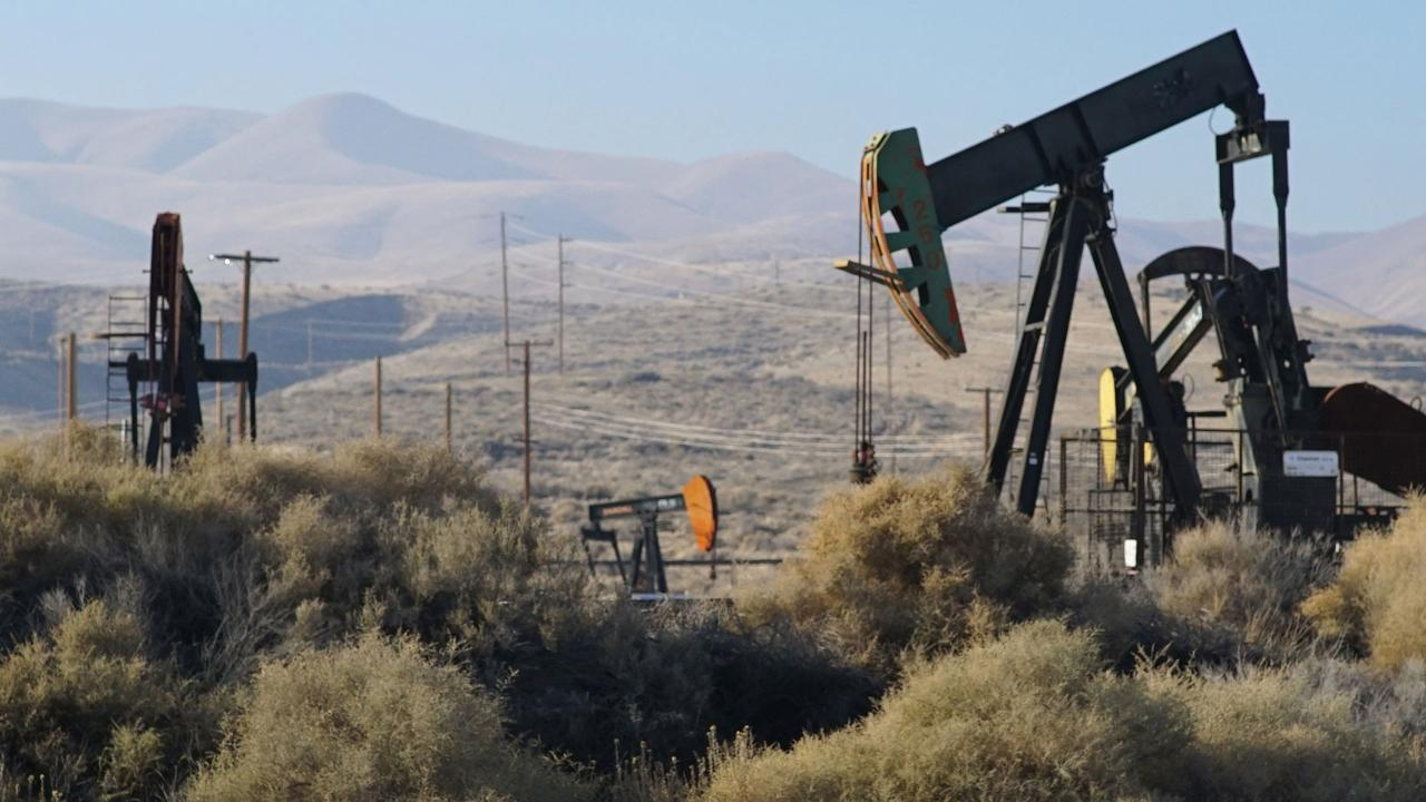 Fueling Change: Two Neighboring Towns Pit the Legacy of Oil Against a Renewable Future